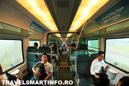 Passengers ride onboard the KLIA Transit express train, which features air-conditioned cabins and wireless internet access. The travel time is approximately 30 minutes from Salak Tinggi to KL Sentral.